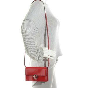 Red Gucci crossbody/clutch